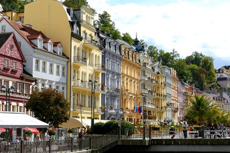 Karlovy Vary, Czechia - September 11, 2017: A row of colourful tenement houses with its ornamented facades by the promenade is one of the many tourist attractions of this wonderful spa town