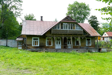 Zakopane, Poland - August 15, 2017: This neglected house looks completely abandoned and significantly ruined. It is a villa built of wood circa 1900, which used to be named Stefa