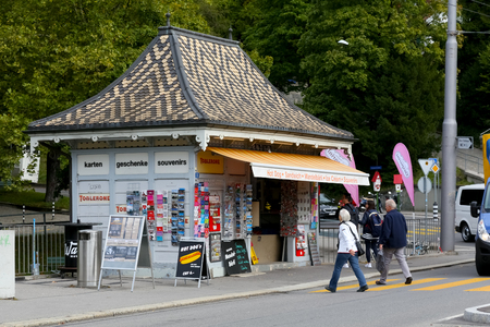 Bern, Switzerland - September 18, 2017: Kiosk with various souvenirs and gifts also offers something to eat and ice cream.