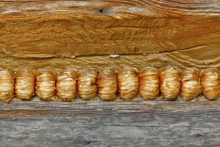 The joining of wooden logs and their sealing. This is a fragment of the structure of a wooden house that is in Zakopane i n Poland
