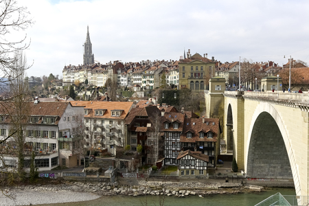 Bern, Switzerland - February 14, 2018: The dense urban development of the medieval Old Town with the dominant tower of the cathedral. This is a most visited part of this amazing city.