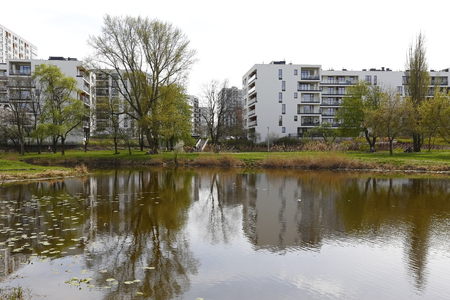 Warsaw, Poland - April 15, 2018: The lake is located in the immediate vicinity of multifamily houses. It is one of the districts of the city where residents have the close access to nature.