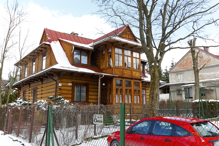 Zakopane, Poland - March 21, 2018: Traditional wooden property dates back to about 1929 and is locally known as Villa Nasza. The building is registered in the Municipal Records of Monuments Editorial