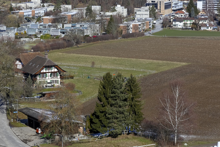 Bern Switzerland - February 13, 2018: A housing estate is seen on the outskirts of Bern and there is also agricultural land here. Sajtókép