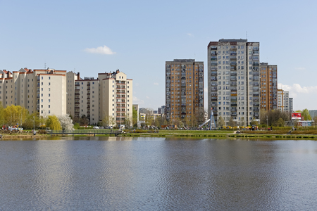 Warsaw, Poland - April 14, 2018: Multi-storey residential buildings made of prefabricated concrete slabs are seen by the lake. These multi-storey buildings belong to a district locally called Goclaw