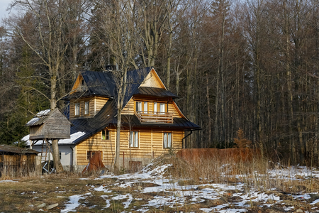 Zakopane, Poland - March 23, 2018: A family house dating back to around 1925. This wooden building in the immediate vicinity of the forest is seen Editorial