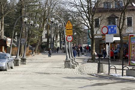 Zakopane, Poland - March 23, 2018: Stylish lanterns, three on each side of Krupówki Street, are a sign that the famous pedestrian zone begins here. Redakční