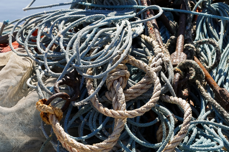Old and worn fishing lines are visible in fishing port in Kolobrzeg , Poland Stock Photo