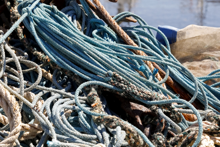 Fishing ropes are stored in the warehouse, which can be seen in the fishing port in Kolobrzeg , Poland Stock Photo