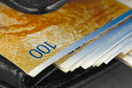 Black wallet with Swiss francs, which have not been hidden very well in it Stock Photo