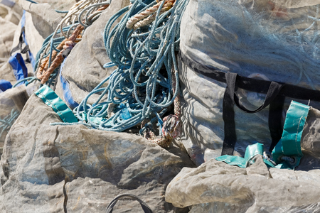 Storage of fishing nets and ropes in huge bags is seen in the fishing port in Kolobrzeg , Poland. Stock Photo