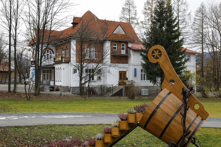 Zakopane, Poland - November 16, 2018: A large brick villa in front of which there is a flowerbed in the shape of a wooden scoop for milk. This house is locally known as Dr. Rozycki's house.