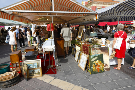 Nice, France - September 17, 2018: Many people came to Cours Saleya, the most famous City Market, which offers antiques and other products on this day. Redactioneel