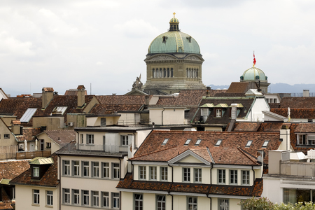 Bern Switzerland - September 14, 2018: Above the roofs of residential buildings rises the dome of the Swiss Federal Assembly seat, the Federal Palace.