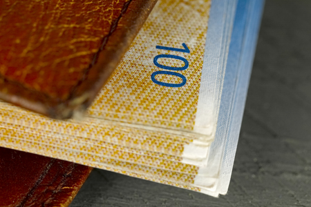 Leather wallet and Swiss franc banknotes in it Stock Photo