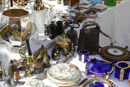 Nice, France - September 24, 2018: The flea market known as Cours Saleya is a place where you can find a variety of used items, as here at one of the stalls you can see this. Editoriali