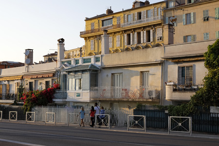 Nice, France - September 17, 2018: A row of nineteenth-century houses of former local fishermen, nowadays these buildings houses contemporary art galleries. There are also restaurants and cafes.