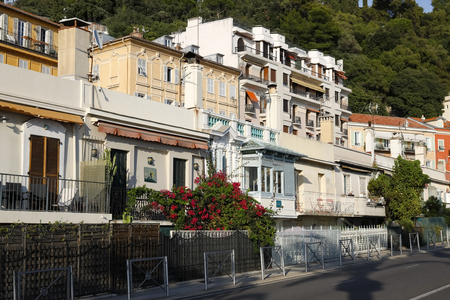Nice, France - September 17, 2018: Small houses of former local fishermen, nowadays there are galleries of contemporary art in these buildings. There are also restaurants and cafes.