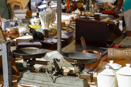 Nice, France - September 24, 2018: The most famous outdoor market in the city, Cours Saleya. There are many stalls with used items for sale.