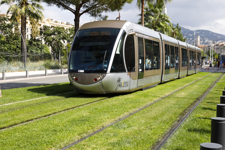 Nice, France - September 24, 2018: The tramway runs on a track which is on a long lawn. This could be the idea of green urban transport.