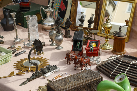 Nice, France - September 17, 2018: The variety of ornamental and functional objects at the stall, which have been observed at the marketplace called Cours Saleya.
