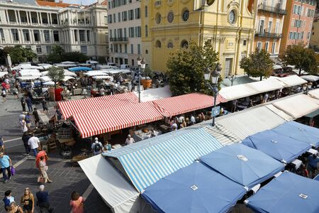 Nice, France - September 17, 2018: There are many stalls on this market which is called Cours Saleya. This place is visited not only by many tourists but also by the inhabitants of the city.
