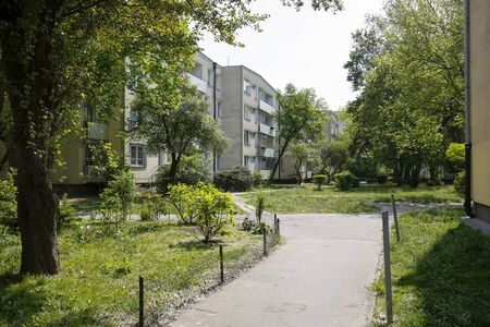 Warsaw, Poland - May 01, 2019: The Saska Kepa district is known for its many trees and lush vegetation, which surrounds single-family and multi-family houses, what can be seen here. Редакционное