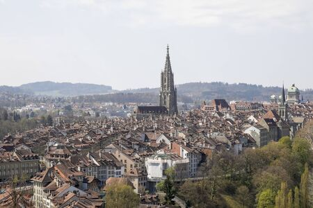 Bern, Switzerland, April 19, 2019: From afar you can see the old town. This capital city with its diverse historical architecture is a place visited by many tourists from all over the world.