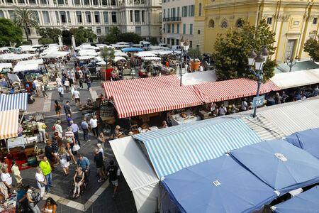 Nice, France - September 17, 2018: On business day many people came to the famous market called Cours Saleya. Most of the stalls were covered with canvas roofs to protect them from the sun's rays. 報道画像