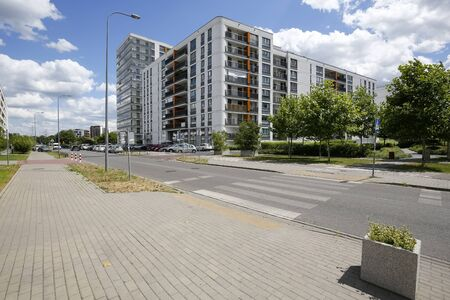 Warsaw, Poland - July 02, 2019: Modern buildings. This modern part of the city district is known locally as Goclaw and is known for its large green areas in close proximity to residential areas. Redakční