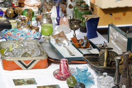 Nice, France - September 17, 2018: Various items were placed on the table of one of the stalls at the famous marketplace called Cours Saleya.