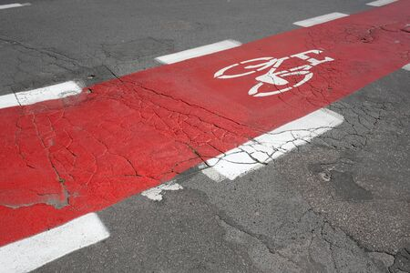 The bicycle lane was painted red and the bicycle symbol was painted there. This is a part of the street in Kolobrzeg in Poland. Reklamní fotografie