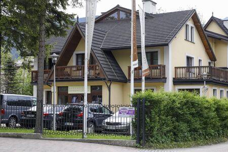 Zakopane, Poland - July 01, 2019: A view towards a restored and modernized residence with the local name Sienkiewiczowka.