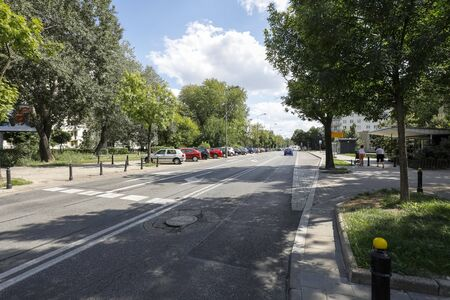 Warsaw, Poland - August 11, 2019: A wide city street leads through a residential area called Saska Kepa. Editöryel