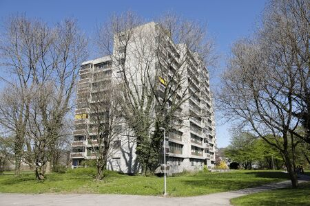 Bern, Switzerland - April 20, 2019: Concrete buildings among trees and plants is the area of a housing estate with multi-family buildings. It is the residential district of Murifeld – Wittigkofen Editöryel