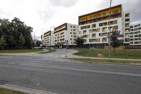 Warsaw, Poland - September 20, 2019: Modern apartment blocks in a housing estate called Goclaw are seen on a cloudy day. Editöryel
