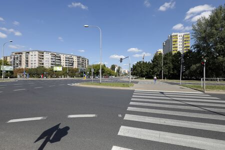 Warsaw, Poland - August 23, 2019: There is crossroads of wide streets with pedestrian crossing in a housing estate called Goclaw. There are residential buildings here that have been built for many families. Editöryel