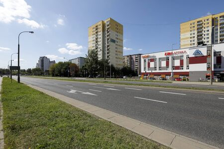 Warsaw, Poland - August 23, 2019: There is a wide street that leads through a housing estate called Goclaw. There are residential buildings here that have been built for many families.