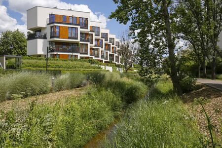 Warsaw, Poland - July 02, 2019: Modern architecture among green areas. It is a part of a large housing estate known locally as Goclaw