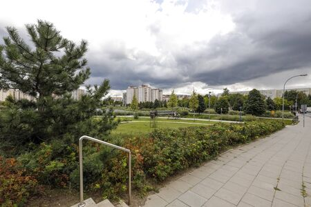 Warsaw, Poland - September 20, 2019: Sidewalk by the park which is part of a housing estate called Goclaw. There are many plants here between the blocks of flats Editöryel