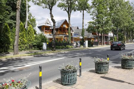 Zakopane, Poland - July 10, 2019: On the other side of the street is a house dating back to 1888, it was previously known as Anielowka. At present it houses a restaurant locally called Mala Szwajcaria 報道画像