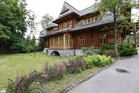 Zakopane, Poland - July 10, 2019: Historical wooden house with a shingle roof, which used to be an ordinary residence, now houses the Tatra Museum. The building is locally called the Oksza Villa.