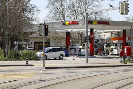 Bern, Switzerland - April 20, 2019: There is a petrol station Migrol, which is located on the other side of the street, behind the tram tracks.