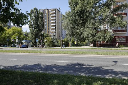 Warsaw, Poland - August 23, 2019: There are block flats among trees that are located in housing estate called Goclaw. There are residential buildings here that have been built for many families. Editöryel