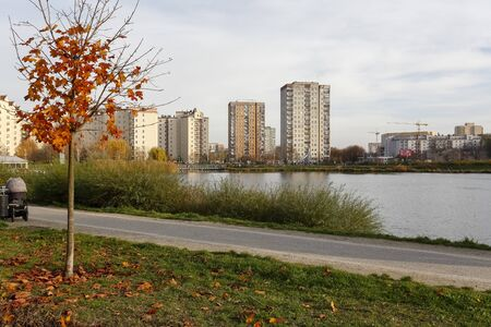 Warsaw, Poland - November 17, 2019: Autumn has already come over the housing estate by the lake. The colors of autumn can already be seen here in the Goclaw district.