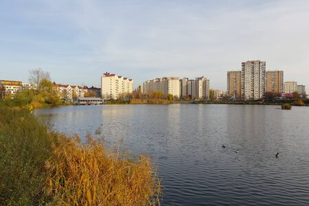 Warsaw, Poland - November 17, 2019: The view of the Goclaw housing estate has already taken on the colors of autumn, which can be seen here around the lake Sajtókép