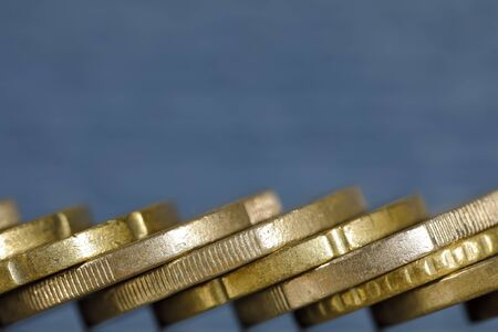 The euro coins are shown against a colored background and are stacked at an angle to the base. Reklamní fotografie