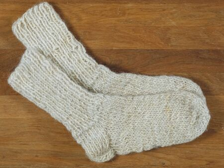 A pair of handmade woolen socks. These traditional, warm winter socks were made by Polish highlanders in the Podhale region, near Zakopane. The wool used to make these socks was also made at home. 写真素材