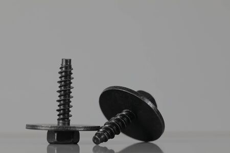 Here are bolted connections, black coated special screws that are targeted for use in the automotive industry. Banque d'images
