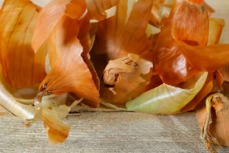 Stacked parts of onion skin. These are the remains of onion peeling. Stock Photo